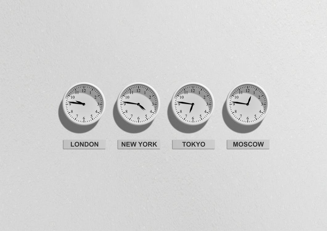 series of clocks on the wall simulating different time zones for conference calls