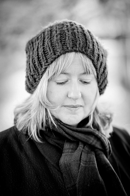black and white picture of non profit owner janet in wool cap and scarf