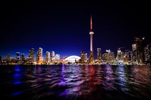 toronto city downtown skyline waterfront at night with CN tower and rogers centre