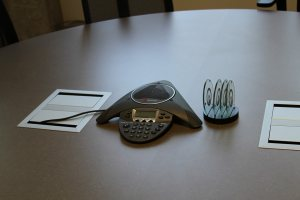 conference call speakerphone in meeting room
