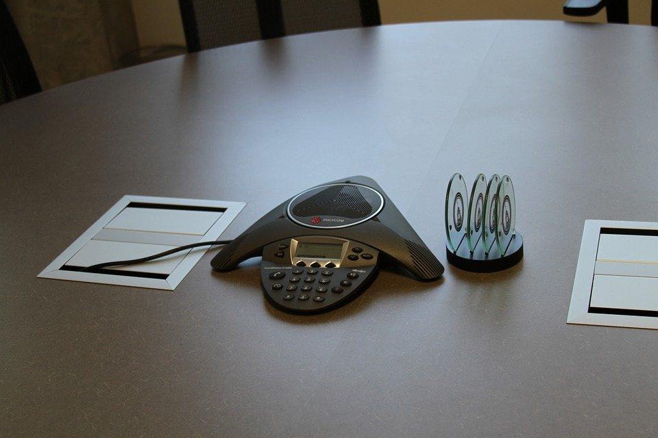 conference call speakerphone in meeting room
