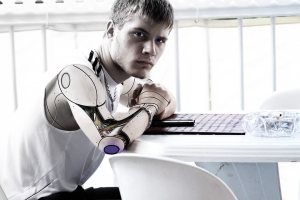 Man sitting at table with robotic arm in futuristic setting