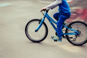 boy riding on a bicycle in the street