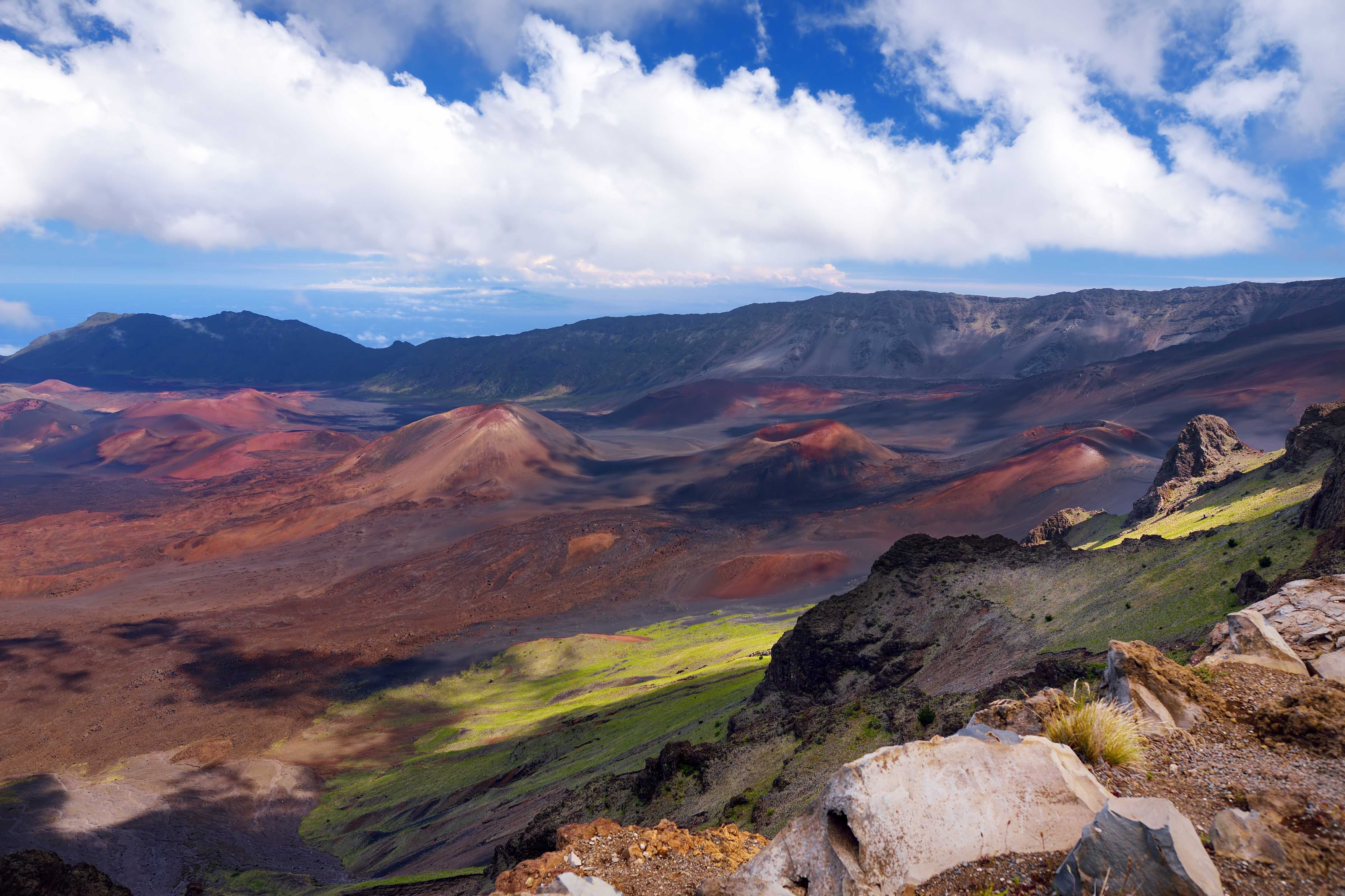 Stunning landscape of Haleakala volcano crater taken at Kalahaku overlook at Haleakala summit. Bird's-eye view of the crater floor and the trails snaking around the cinder cones below. Maui, Hawaii