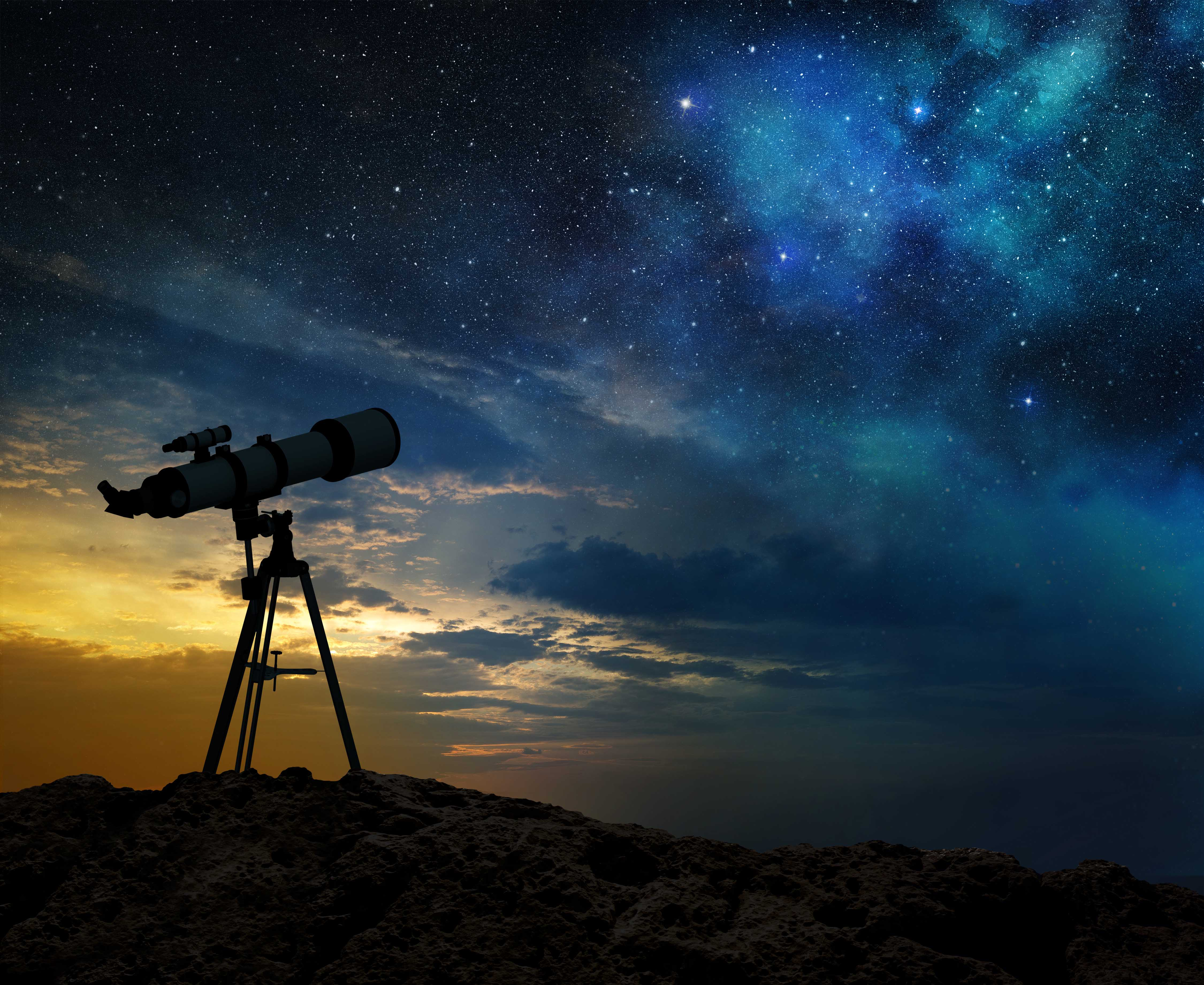 view of a telescope with stars in the sky