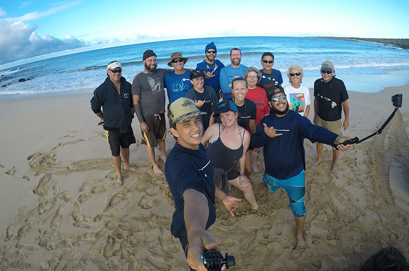 Our guides taking a selfie during a paid service day in Hawaii.