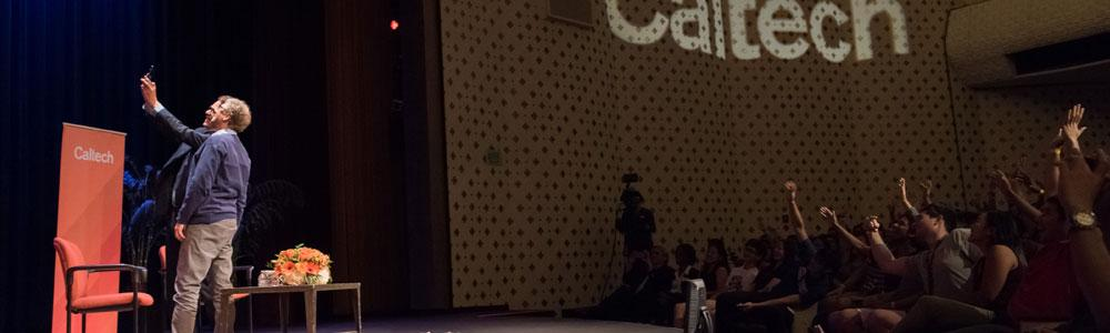 photo of Bill Gates on stage at Caltech's Beckman Auditorium