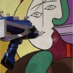 Scanning an oil painting with an X-ray fluorescence spectrometer.
