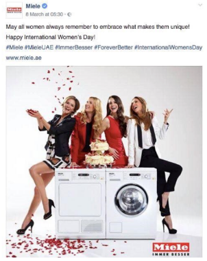 Meiele tweet of a picture of four women sitting on a washing machine