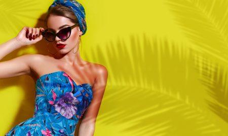 AdobeStock woman yellow wall tropical palm tree sunburn, The Best Natural Sunburn Remedies