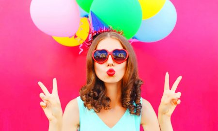 AdobeStock_147302941-woman-red-wall-baloons-party-hat-heart-sunglasses-peace, How to Deal With Turning 30