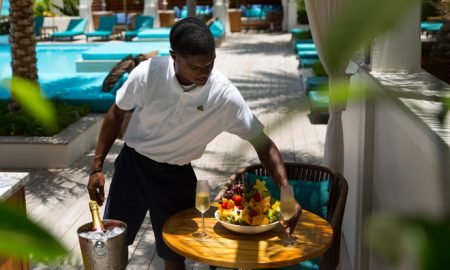 Zemi-Beach-House-Anguilla-BTS-service-man-fruit-champagne