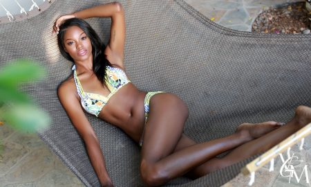 Black woman laying in bikini