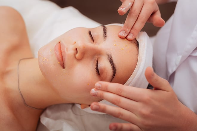What-is-a-Facial-Massage-and-How-to-Do-It-woman-getting-her-face-massaged