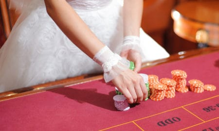 how-to-organize-an-epic-casino-themed-wedding-bride-at-roulette-table