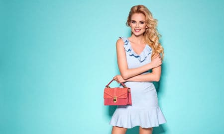 the-best-colors-to-wear-to-match-your-blonde-hair-blue-dress-pink-bag-main-image