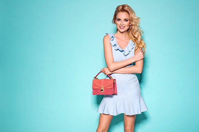 the-best-colors-to-wear-to-match-your-blonde-hair-blue-dress-pink-bag