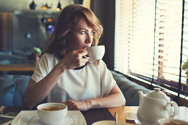 10-life-skills-every-woman-should-have-woman-sipping-tea-by-herself-peacefully