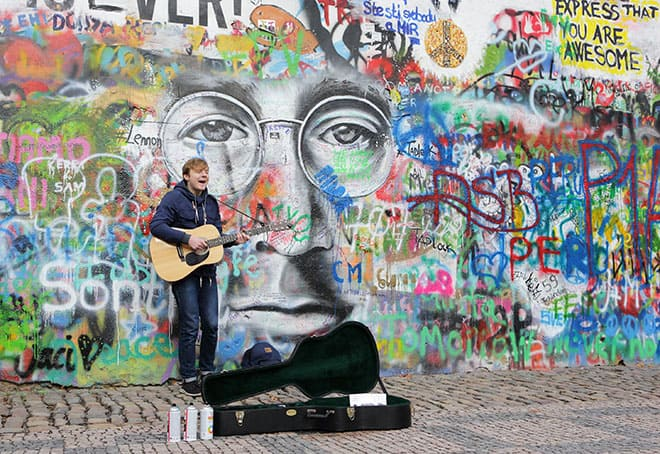 an-insta-perfect-guide-to-prague-man-plays-guitar-at-john-lennon-wall-1