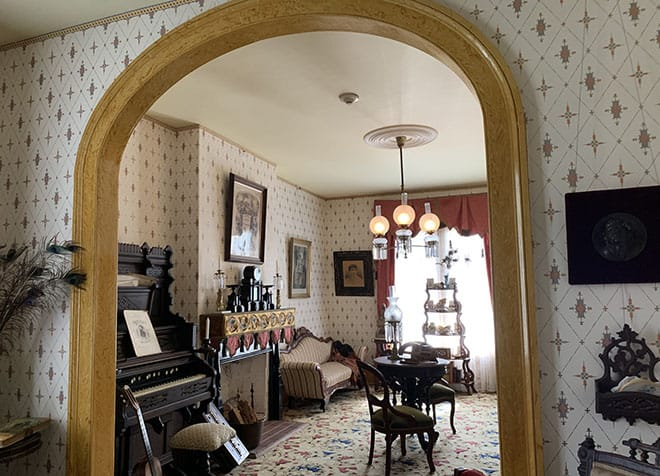 historic-whaley-house-interview-americas-most-haunted-house-dean-glass-malorie-mackey-parlor-living-room-archway