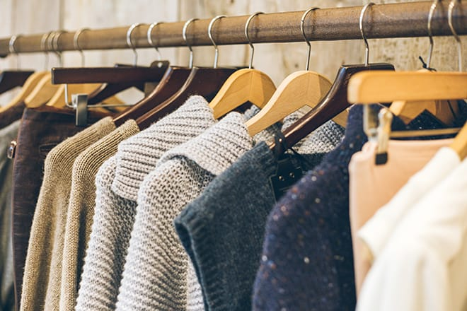 How-To-Shop-For-Ethical-Fashion-On-A-Budget-clothes-hanging-on-a-rack
