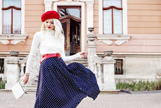Lovely-Midi-Skirt-Outfits-to-Try-This-Fall-girl-in-polka-dot-midi-dress-and-red-baret
