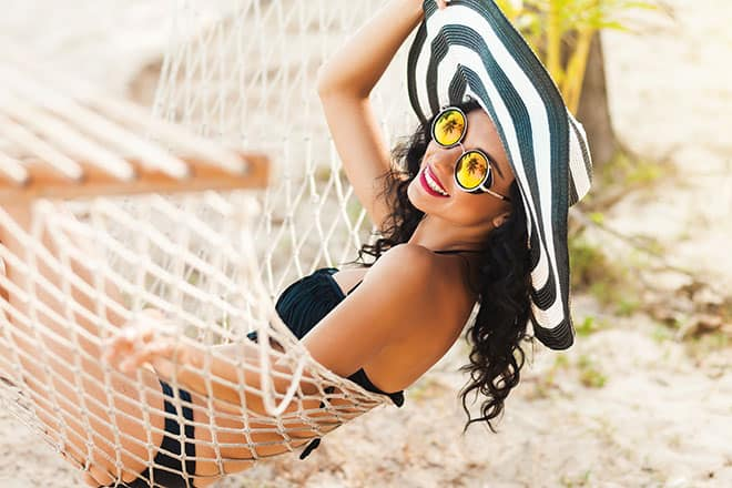 Ultimate-Beach-Styles-for-Summer-woman-in-a-beach-hat-and-bikini