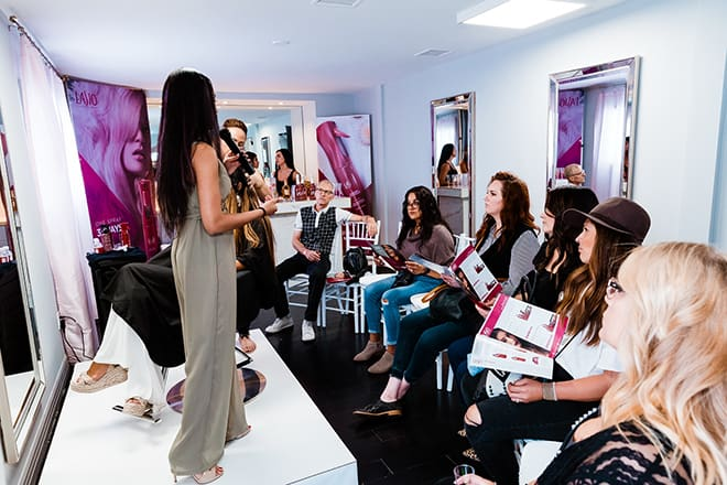 Lasio-Live_Life_Frizz-Free-Pop-Up_event-hypersilk-texturizing-keratin-mist-on-stage-demonstration