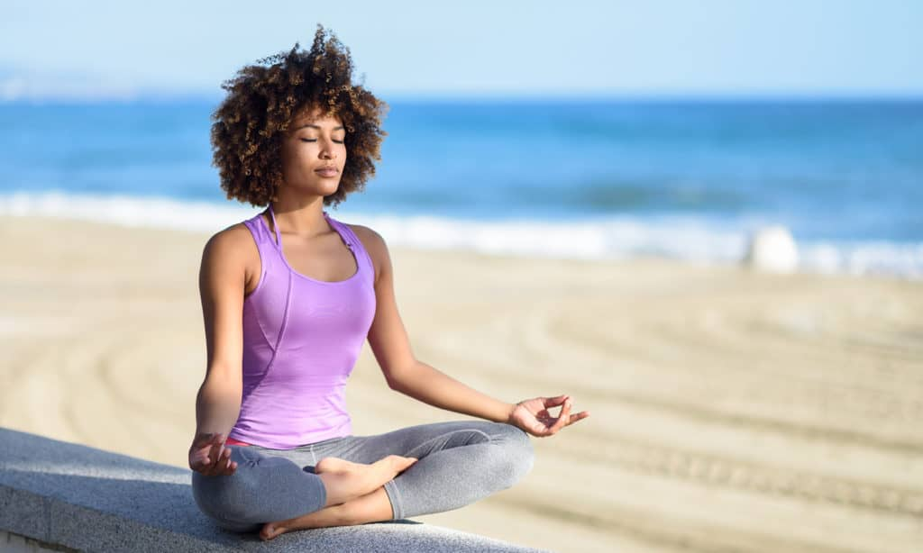 find-the-perfect-style-of-yoga-for-you-woman-doing-yoga-on-the-beach-main-image
