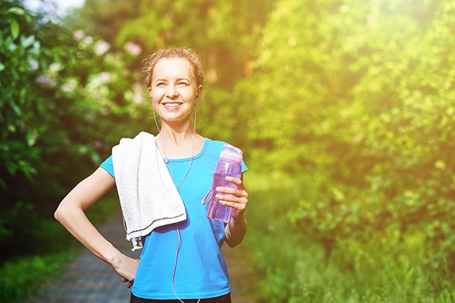athletes-prepare-for-a-big-game-woman-holding-water-bottle