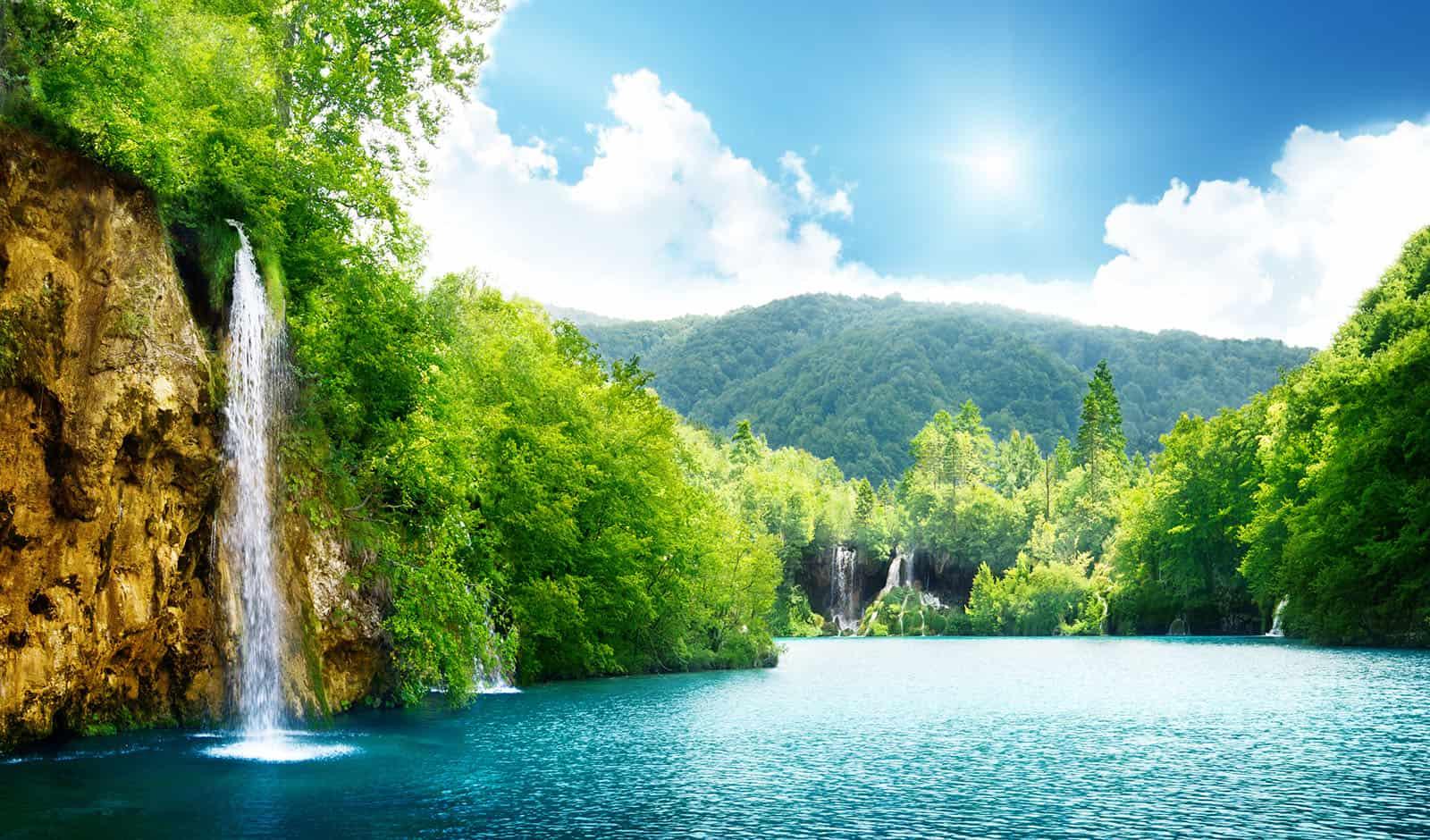 serene-outdoor-scene-with-waterfall-and-greenery