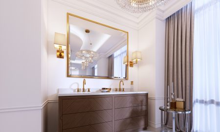 Modern wooden vanity with a mirror in a gold frame and sconces o