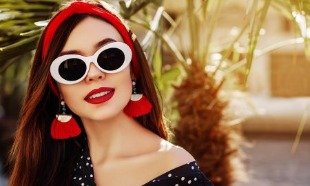 Outdoor close up portrait of young beautiful fashionable woman w