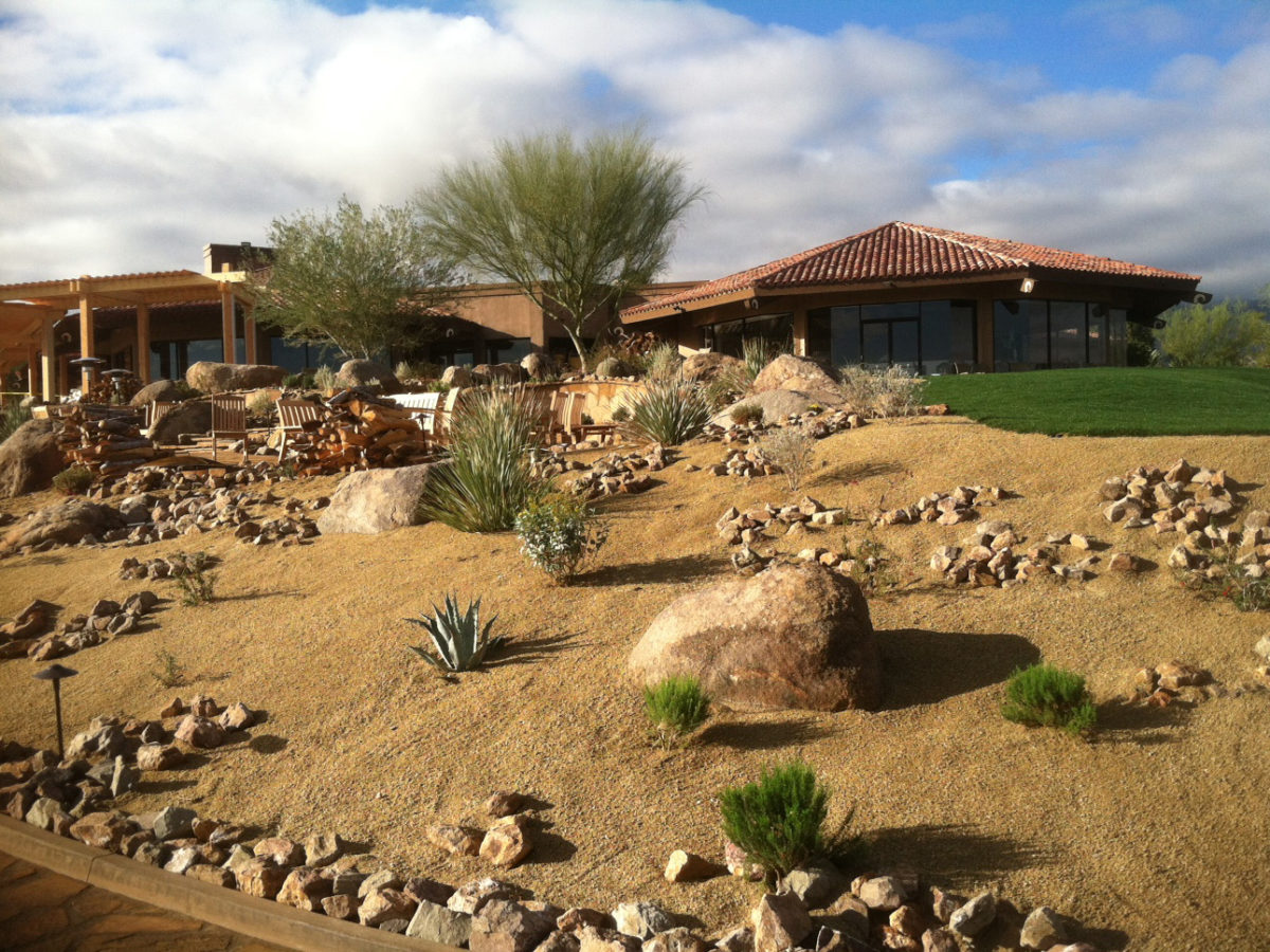Boulders placed naturally on hillside in front yard