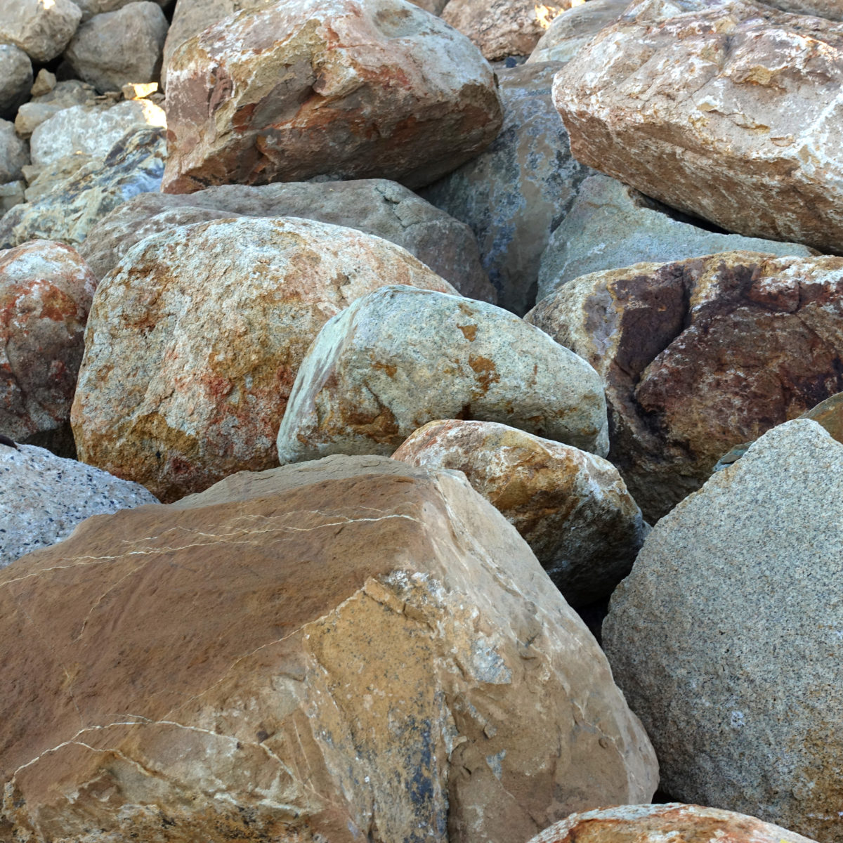 Group of brown ale landscape boulders in rock yard