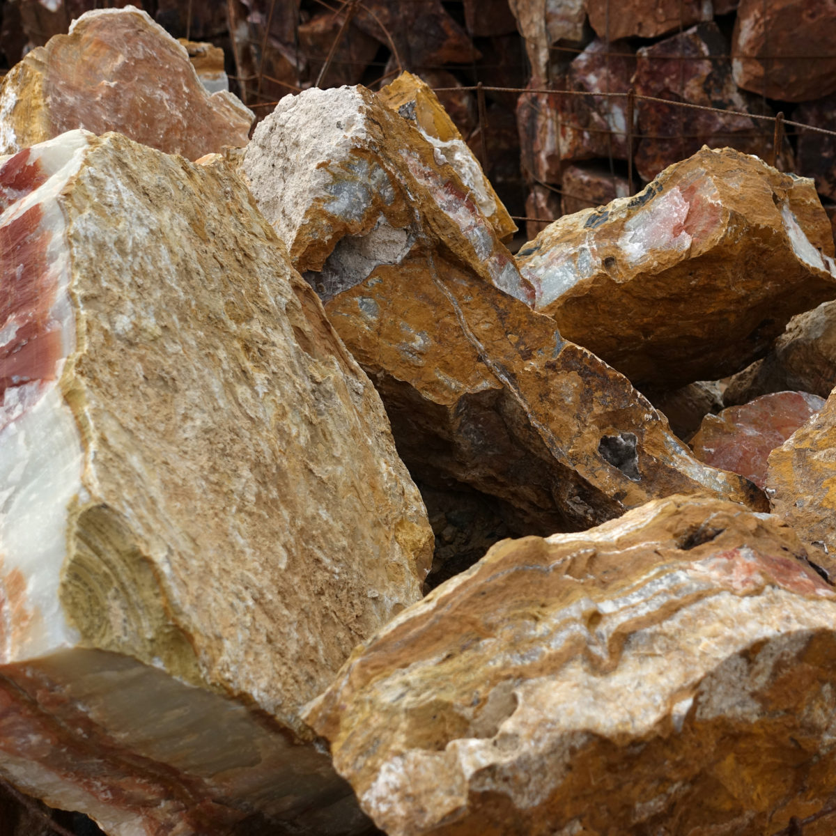 Brown red mexican onyx boulders