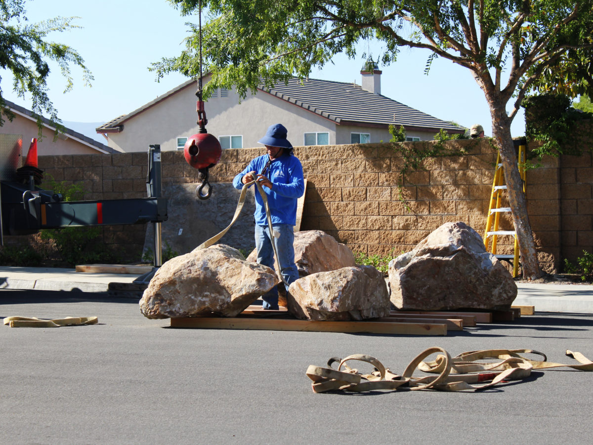 harnessing boulder for placement in yard