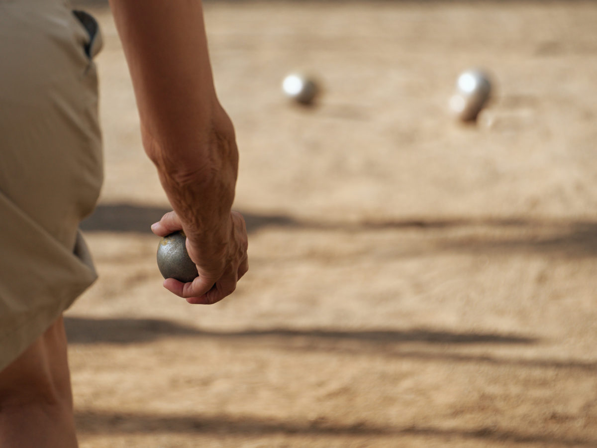 throwing on bocce ball court with top dressing