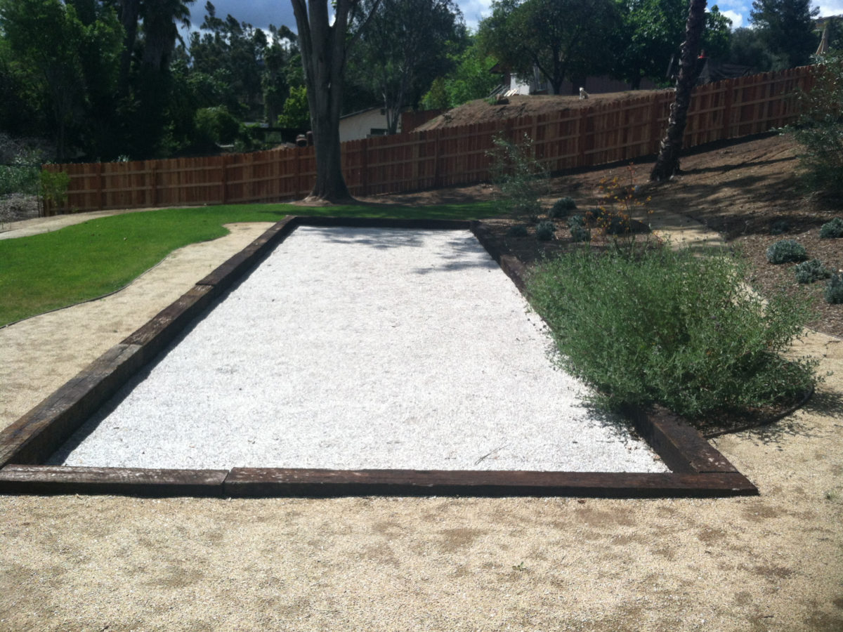 bocce ball court with white seashell mix soil