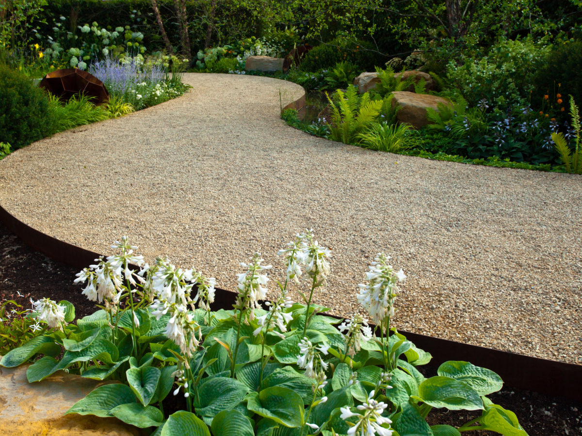 Decomposed granite pathway curved through garden