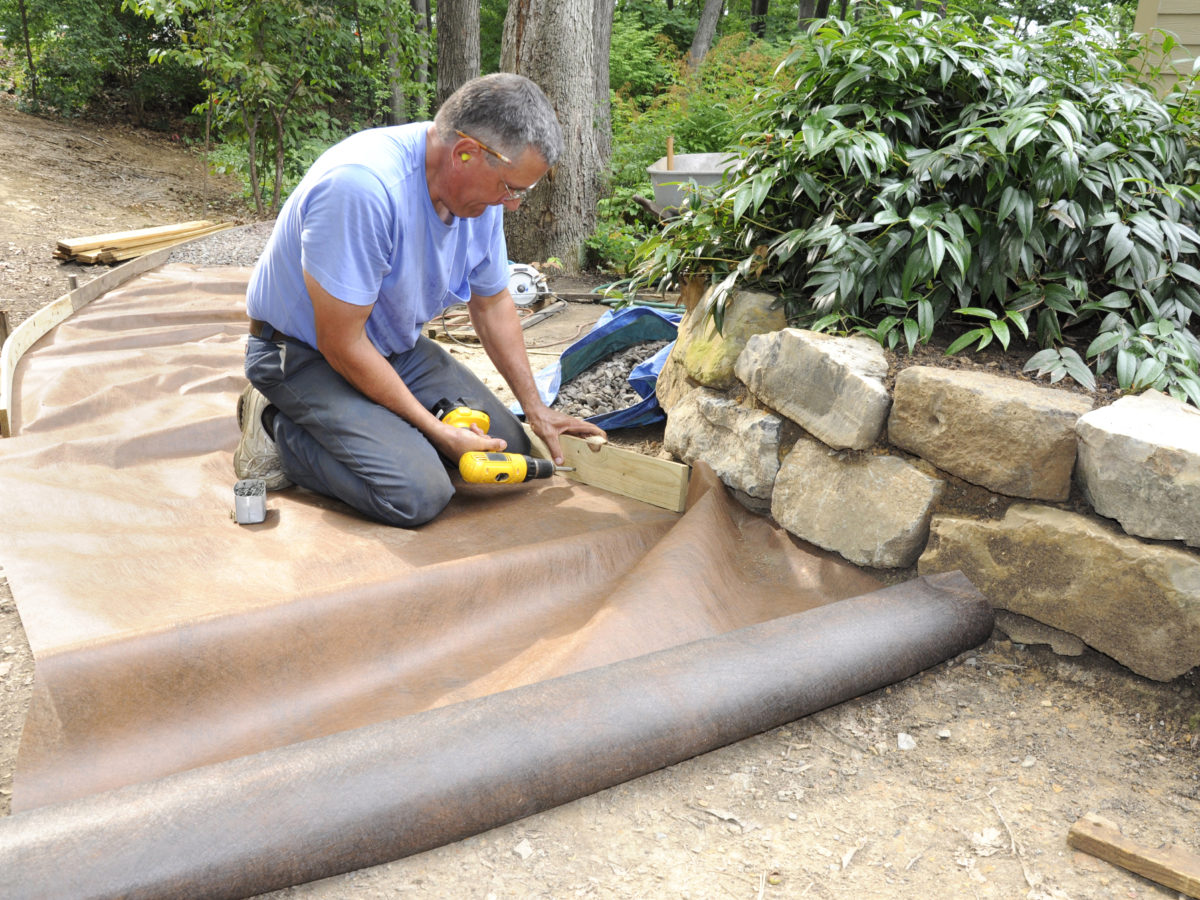 Installing weed barrier fabric for decomposed granite pathway