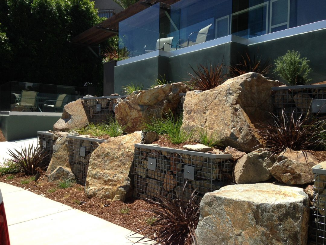 Large boulders next to pathway in yard