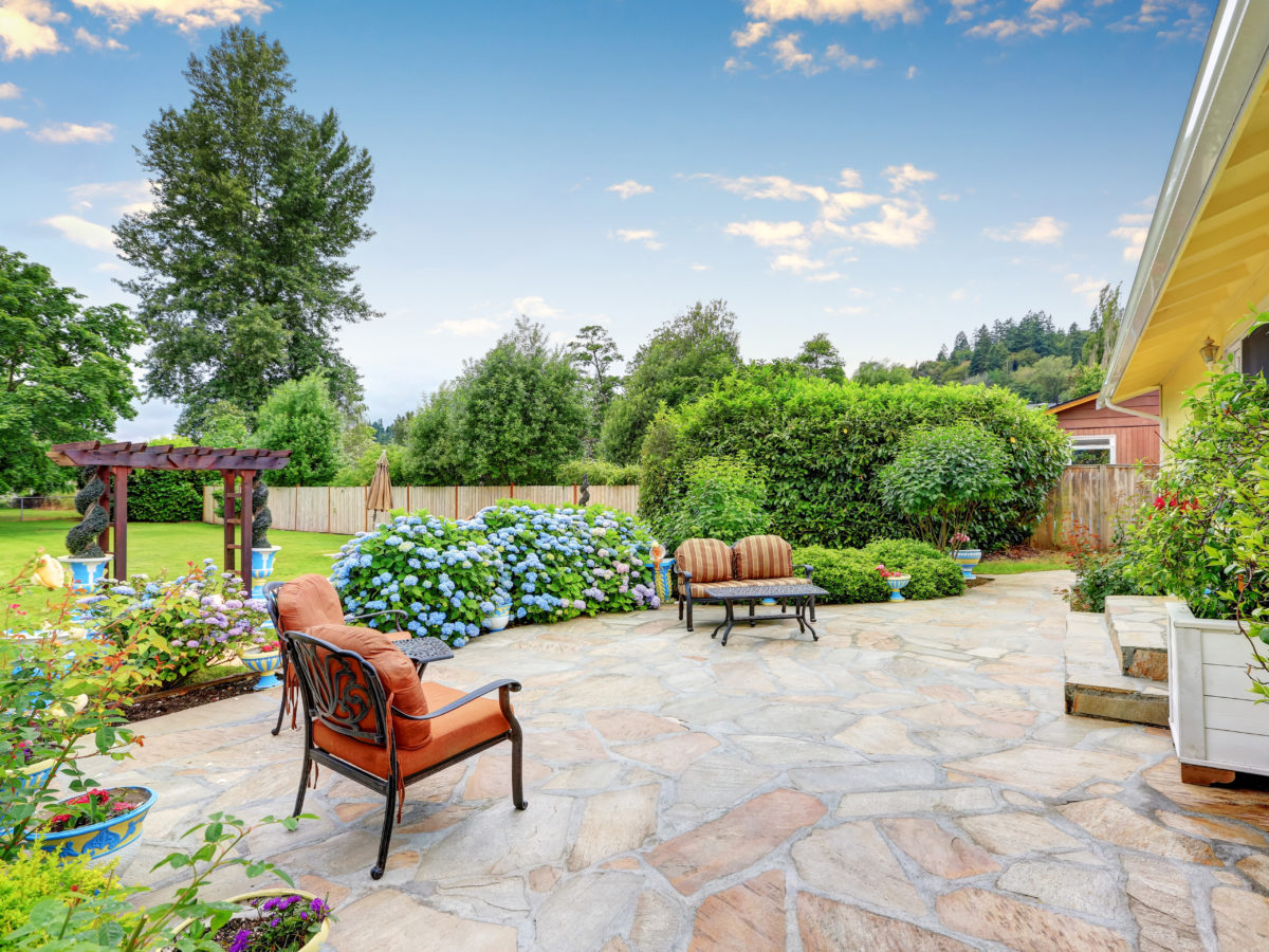 Backyard flagstone patio with furniture