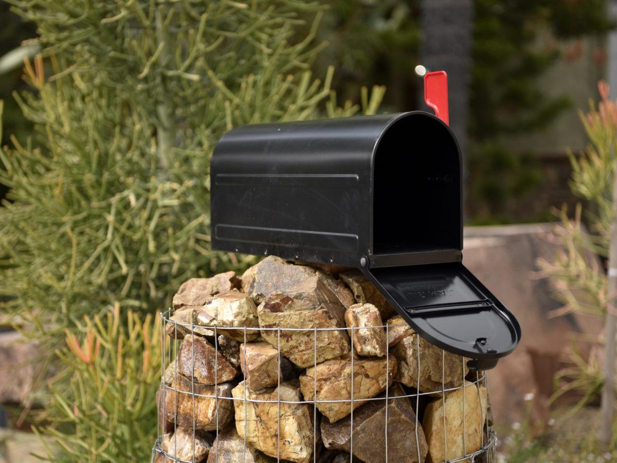 Gabion basket mailbox with crushed rock