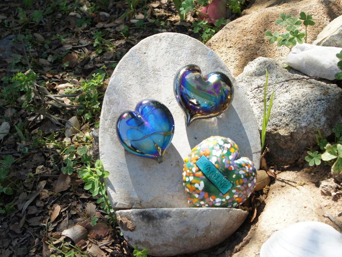 Mosaic rock garden art piece next to pathway