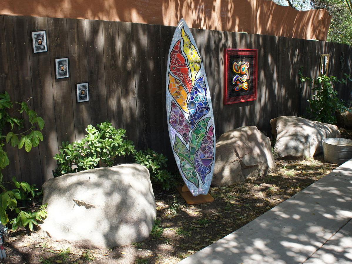 Mosaic rock garden art piece by boulders