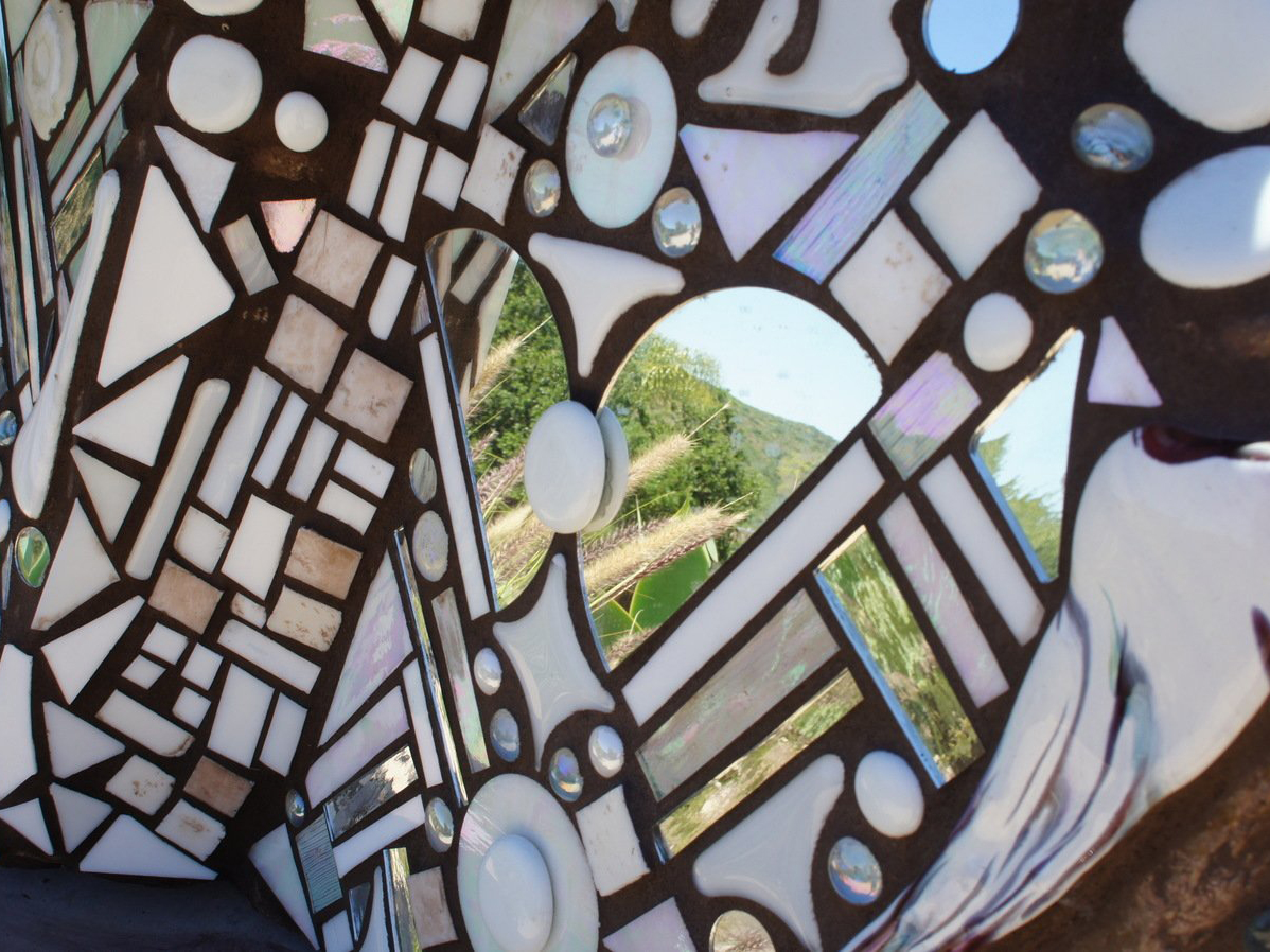 Glass and mirror on mosaic rock art piece