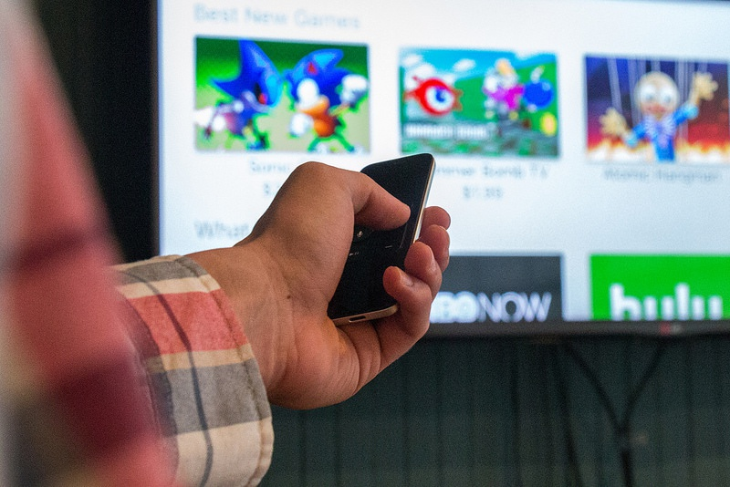 Closeup of Jon Emminizer's hand showing off the Apple TV
