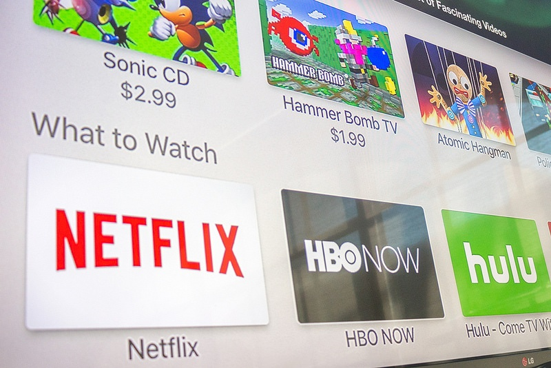 An array of Apple TV apps: Sonic CD, Hammer Bomb TV, Atomic Hangman, Netflix, HBO Now, and Hulu