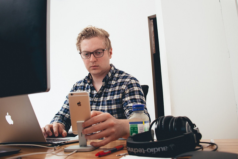 Devin Fountain checking his prototypes from his iPhone 6